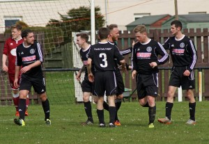 Craig Lowe is congratulated on his goal.